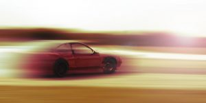 drift car motion blur sunrise or sunset