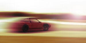 drift car motion blur sunrise or sunset