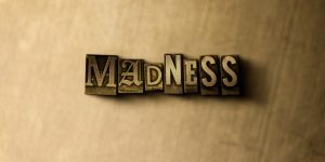 MADNESS – close-up of grungy vintage typeset – 3D rendered