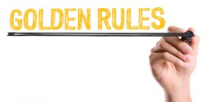 Hand with marker writing: Golden Rules
