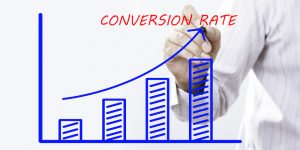 """CONVERSION RATE"" text with hand of young businessman point on virtual graph Blue line and bar showing on increasing with background -business, finance, salary, crisis, and development concept"