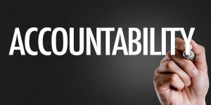 Hand writing the text: Accountability