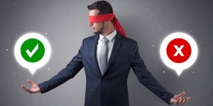 Blindfolded businessman trying to choose