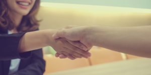 close up businesswoman handshake with partner,ceo leader hand shake for agreement or approve or deal financial concept